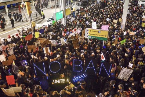 Thousands of protesters gathered at JFK airport in New York City Saturday in protest of people detained under Trump