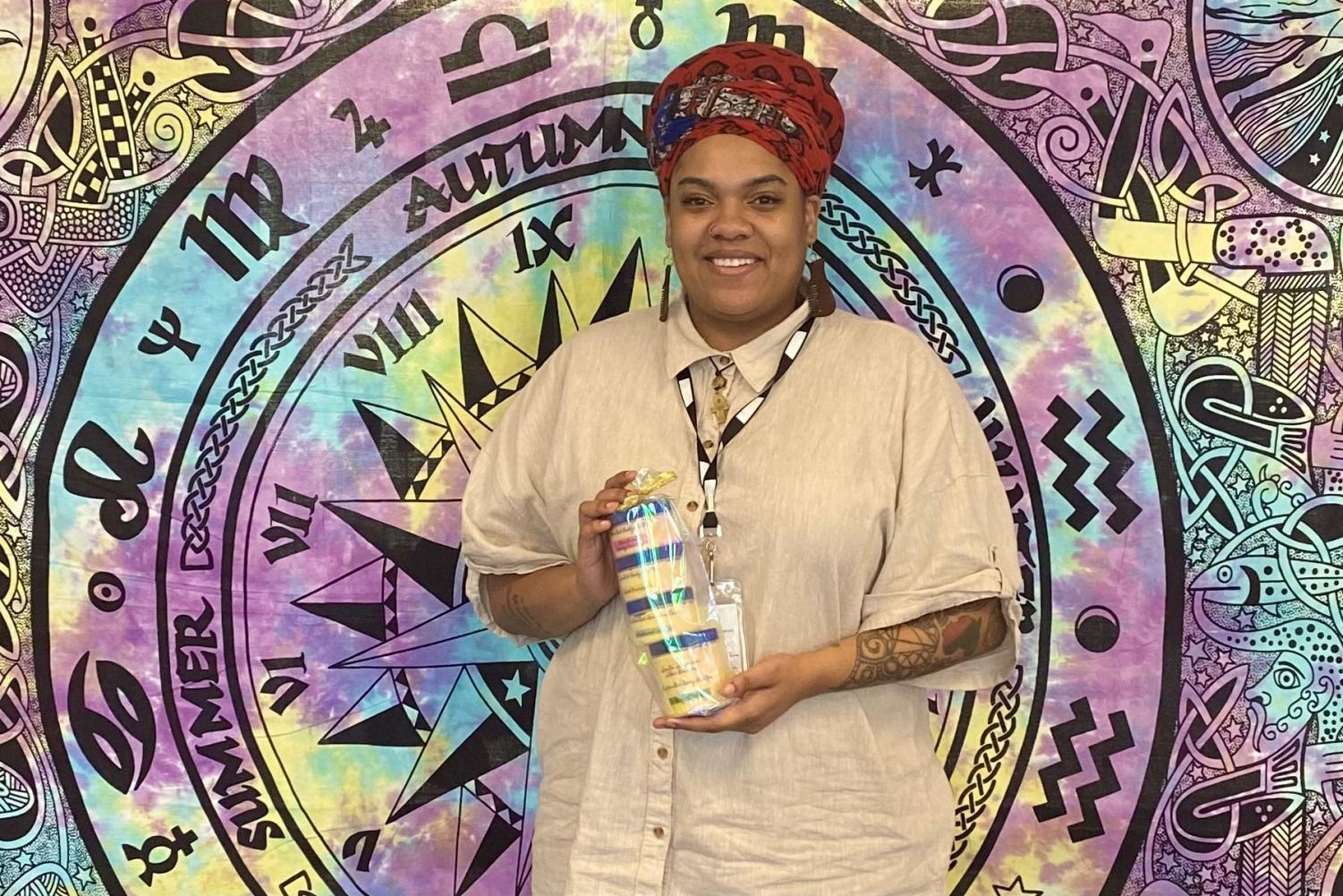 Ms. Riddles showcases her shea butter business.
