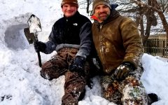 Dr. O'Connell and his son have fun in the snow.