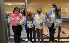 (from left to right) Mahagani Burley, Makenzie Cresswell, Betsy Ponder, and Aleya Kennedy show some of the many bags they've created with Student Council for the homeless, filled with many sanitary and daily items.