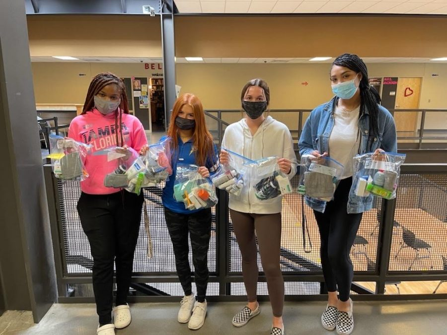 (from left to right) Mahagani Burley, Makenzie Cresswell, Betsy Ponder, and Aleya Kennedy show some of the many bags theyve created with Student Council for the homeless, filled with many sanitary and daily items.