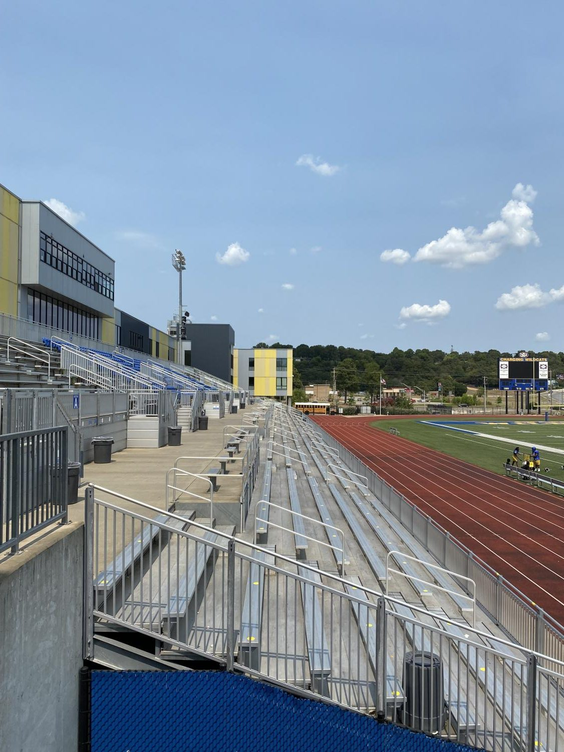 At the North Little Rock High School football stadium yellow dots are placed on the bleachers encouraging social distancing.